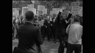 A. Philip Randolph and other leaders marching with crowd Stock Footage