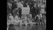 American protesters relaxing at the edge of Reflecting pool Stock Footage