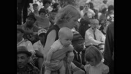 Mother holding baby and daughter in Civil Rights March Stock Footage