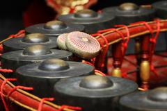 thai musical instrument ,gong instrument for rhythm( select focus at drumstic - stock photo