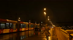 Traffic at the Margarit hid or Margaret bridge at rainy and cold night Stock Footage