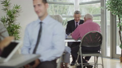 4K Senior couple in meeting with financial advisor or bank manager - stock footage