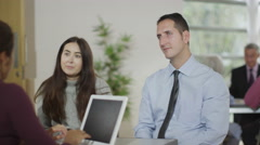 4K Young couple in meeting with financial advisor - stock footage
