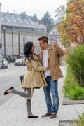 Lovers stroll around the town Stock Photos