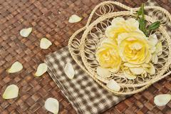 Rose flowers decorate on wooden surface. Stock Photos