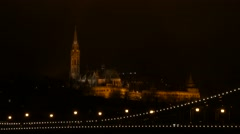 Buda Castle District taken by night with a view on the chains of the bridge Stock Footage