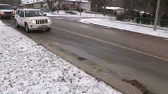 Water main break with water gushing on city street on cold winter day - stock footage