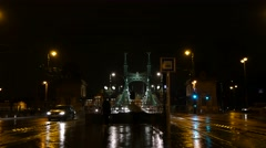 Liberty or Freedom bridge with traffic and tram stop by night Arkistovideo