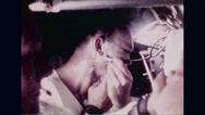 Astronaut Michael Collins shaving in Apollo 11 spacecraft Stock Footage