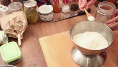 Chef precisely weighting flour Stock Footage