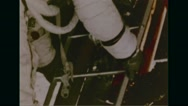 Astronaut Buzz Aldrin descending down the steps to moon's surface Stock Footage