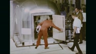 Apollo 11 astronauts in Mobile Quarantine Facility and people assembled to greet Stock Footage