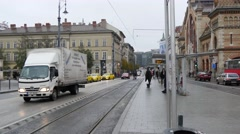 Tram station and street in the near of the Liberty bridge Stock Footage