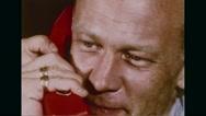 Astronaut Buzz Aldrin talking on phone Stock Footage