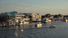 Tour boat passes along wrightsville beach marina, nc, usa Stock Footage