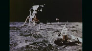Satellite and Lunar Module Eagle set up on moon's surface Stock Footage