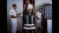 Astronaut tested for effects of removing gravity at astronaut testing program Stock Footage
