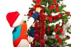 Schoolboy decorate Christmas tree Stock Photos