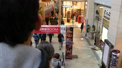 People shopping in one of the biggest shopping malls in Europe Stock Footage