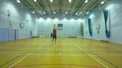 Basketball player makes a 3 point shot Stock Footage