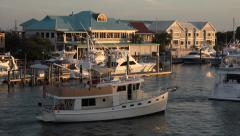 Boat passes along wrightsville beach marina, nc, usa Stock Footage