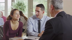 4K Young couple in meeting with financial advisor sign contract and shake hands - stock footage