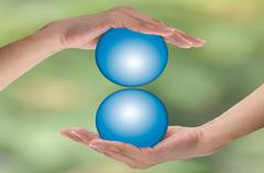 asian woman hand holding blue ball.  safe earth conception, preventive and pr - stock photo