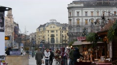 People shopping at the Christmas market in centre of Budapest, winter scene Stock Footage