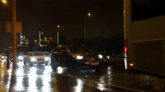 Traffic in Budapest closeup at rainy and cold winter night Stock Footage