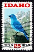Postage stamp USA 1990 Mountain Bluebird and Sawtooth Mountains - stock photo
