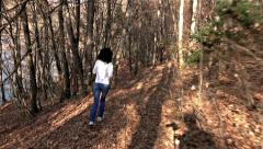 Girl runs through the forest park in the morning. sony 4k steadycam shoot Stock Footage