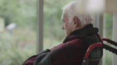 Stock Video Footage of 4K Portrait of lonely senior man in wheelchair sitting by the window