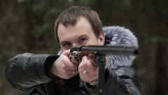 Hunter in the woods with a gun aimed slow motion Stock Footage