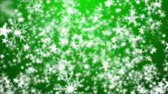 Snowflakes and Stars on a Green Background 2 Stock Footage