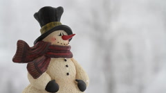 Snowman Figurine with falling snow Arkistovideo
