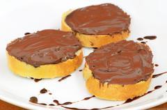 Bread with chocolate cream Stock Photos