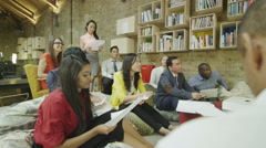 4K Mixed ethnicity business group brain storming in a meeting in modern office - stock footage