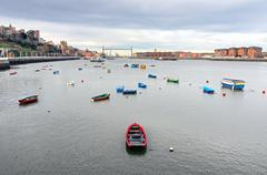 Nervion river with boats and hanging bridge Stock Photos