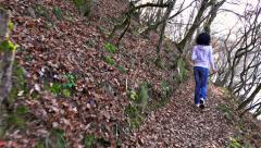 Female jogging in on forest footpath, sony 4k steadycam slow motion shot stoc Stock Footage