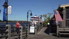 People jog along the river walk, wilmington, nc, usa Stock Footage