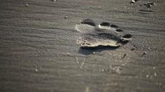 Footprints walking on sand.  Stock Footage