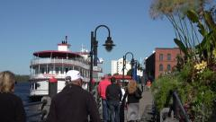 Tourists walk along the river walk, wilmington, nc, usa Stock Footage