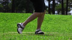 Golfer shooting a ball  - Teeing off Stock Footage