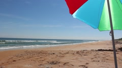 Beach Umbrella on a vacant beach Stock Footage