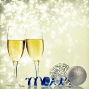 Champagne and christmas decorations against holiday lights Stock Photos