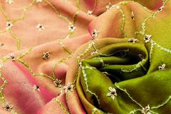Pink and green satin textile - stock photo