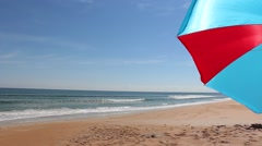 Beach Umbrella on a vacant beach tight Stock Footage