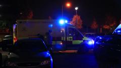 Ambulance picking up a mother and child Stock Footage
