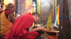 Buddhist monks pray in traditional dress in Tiksey Monastery. Ladakh, India Stock Footage