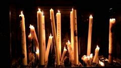 Several candles burning in Lourdes, France Stock Footage